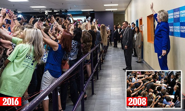 Image shows entire crowd with backs turned to Hillary Clinton to take a selfie