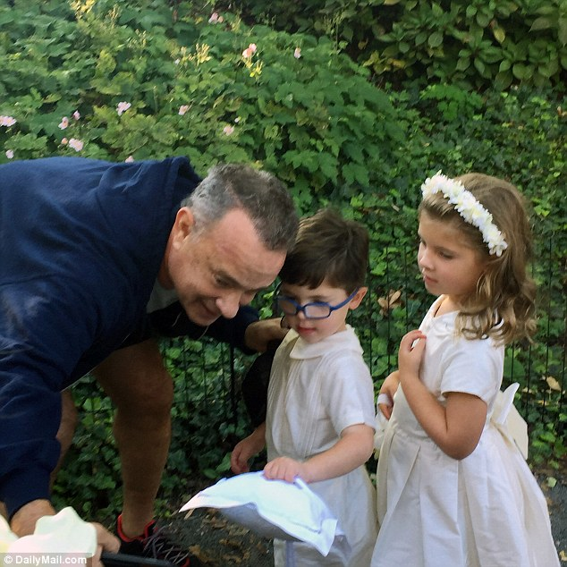 Hanks even took time to meet the ring bearer and flower girl, who were perhaps not yet familiar with his work